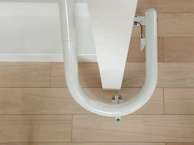 A bird's eye view photo of how the Flow stairlift rail can be installed around a 180 degree bend in the stairs.