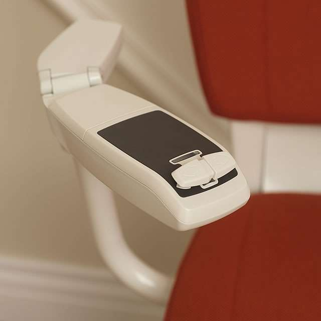 Another close-up photo of the red Flow stairlift arm rest control buttons.