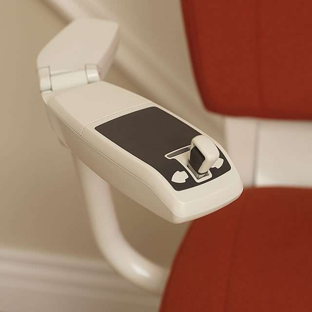 Another close-up photo of the red Flow stairlift armrest short length joystick control.