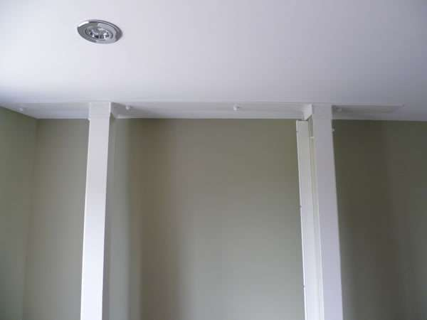 Terry Lifts Harmony through floor wheelchair lift, on the upper floor, the lift has now completed going back down to the lower floor. The photo shows the minimal disruption of the lift guide rails near the wall area as they join the upstairs ceiling