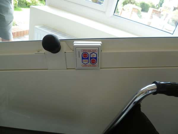Terry Lifts Harmony through floor wheelchair lift, view from inside the lift area, showing the lift up and down control buttons