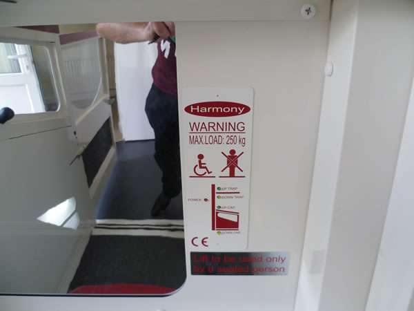 Terry Lifts Harmony through floor wheelchair lift, showing the lift entry / exit door being opened