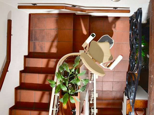 A bird's eye view looking down at the Platinum Curve stair lift, to show the tight curve of almost 180 degrees on the curved stairs.