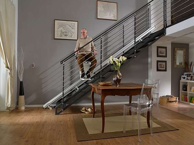 User riding Platinum Horizon stair lift mid-way up the stairs.