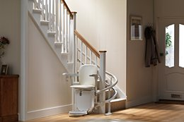 A Stannah stairlift Siena 260-series stair lift for curved staircases