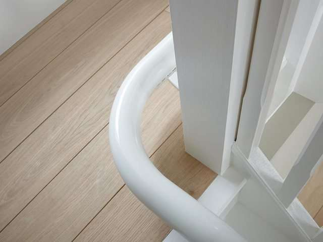 A closer view photo of how the Flow stairlift rail can cope with 90 degree angles on stairs.