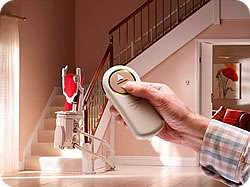 Stannah Sofia stairlift with remote control for curved stairs
