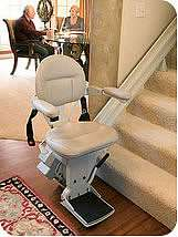 Homeadapt Elite Stairlift seat at bottom of stairs