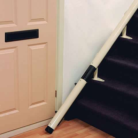 A photo of the bottom of stairs stairlift rail and how it meets the floor.
