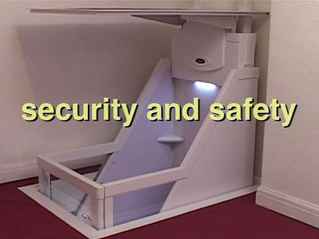 Shown from an angle view, a Wessex Lifts through floor home lift, travelling down the to floor below, with the phrase Security and Safety printed on the image.