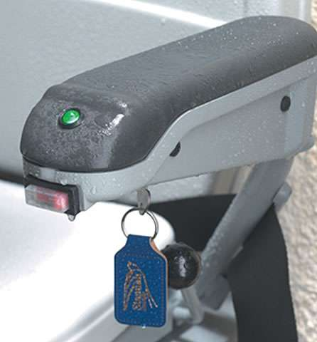 A close-up view of the Stannah 320 outdoor stairlift other armrest showing the button, indicator, and key in position to allow the user to operate the stair lift.